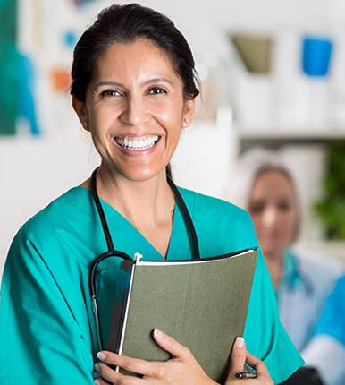 happy nurse holding a folder
