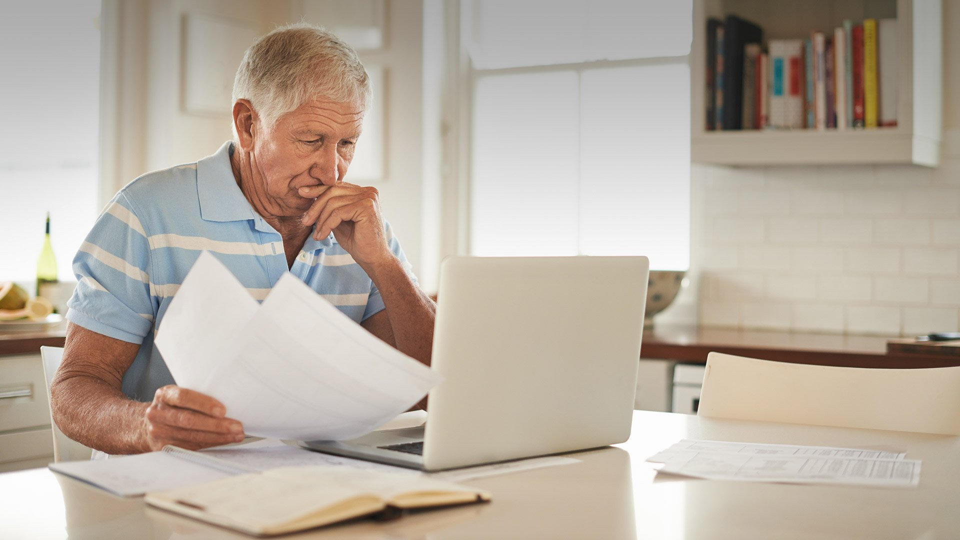 Elderly man staying up to date and following guidance from the CDC and your state and local public health departments.