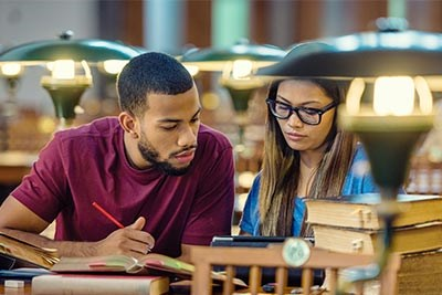 Students Studying in a Library