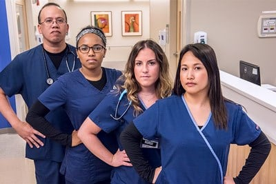 Diverse group of serious hospital nurses