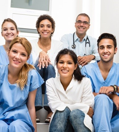 A group of nurses of mixed demographics sat together