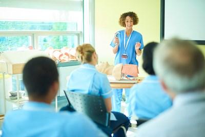 nurse educator in front of classroom
