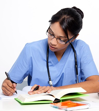 nurse in scrubs studying