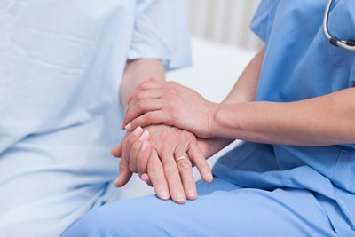 nurse holding patients hands